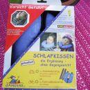 vzglavnik za otroški avto sedež nov še zapakiran cena 8 eur