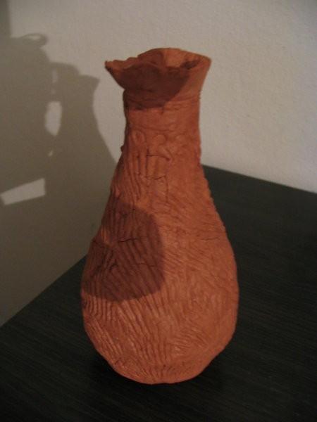 Oranginina steklenička, oblečena v das maslo - vzorček je narejen s školjko